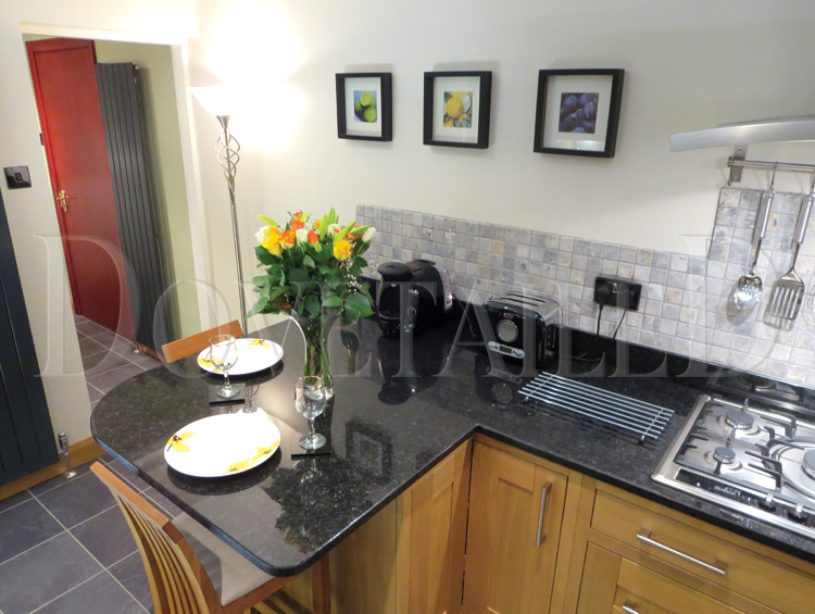 Classic In Frame Solid Oak Doors Complemented By Angolan Black Granite  Worktops Featuring A Curved Breakfast Bar Area. Solid Oak Skirting Boards  Fitted To ...